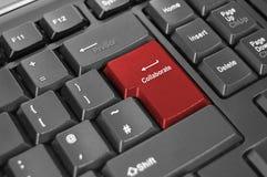 Collaborez entrent dans le clavier de clé Photographie stock libre de droits