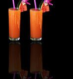 Two glasses of mango juice. Collag, two glasses of mango juice on the black background Royalty Free Stock Images