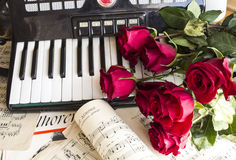 Collage with accordion and red roses. Vintage style collage mix with notes, accordion and red roses stock photos