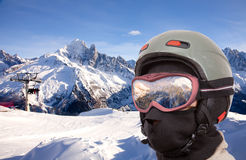 Collage with alpine slope and closeup skier. In helmet Stock Photos