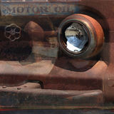 A collage of an antique rusted truck. A collage of a rusted truck with transparent layers of parts and signs stock image