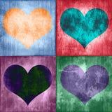 Collage av fyra färgrika tappninghjärtor Arkivfoto
