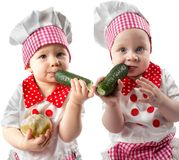 Collage of Baby cook boy and girl wearing chef hat with fresh vegetables Royalty Free Stock Images