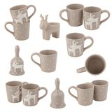 Collage from beige cups with deer and different decorations, isolated on white. Collage from beige cups with deer and different decorations, isolated on the Stock Image