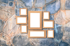 Collage of blank brown wooden frames , interior decor mock up on. Marble wall, vintage style Royalty Free Stock Photography