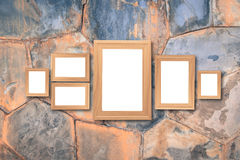 Collage of blank brown wooden frames , interior decor mock up on. Marble wall, vintage style Stock Image