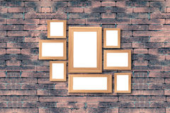 Collage of blank brown wooden frames , interior decor mock up on. Old brick wall, vintage style Stock Photos