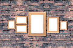 Collage of blank brown wooden frames , interior decor mock up on. Old brick wall, vintage style Stock Photo