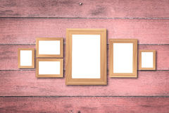 Collage of blank brown wooden frames , interior decor mock up on. Old pink wooden wall, vintage style Stock Photos
