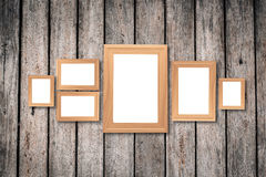 Collage of blank brown wooden frames , interior decor mock up on. Old wooden wall, vintage style Royalty Free Stock Photos