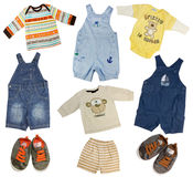 Collage of boy clothing isolated on white. Collage of male kid clothing. Boy clothes isolated on white Royalty Free Stock Photography