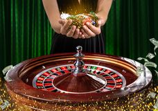 Collage of casino images with a close-up vibrant image of multicolored casino roulette table with poker chips in woman royalty free stock image