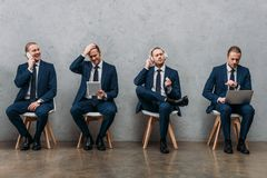 collage of cloned young businessman royalty free stock photos