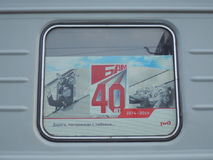 The collage in the coach`s window. The 40th anniversary of the Baikal-Amur railway Royalty Free Stock Images