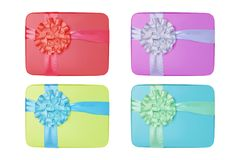Collage of color gifts with bows isolated on white background Stock Image
