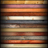 Collage with colorful different wood boards. On dark background for your design Stock Image