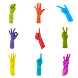 Collage of colorful rubber gloves to clean Royalty Free Stock Images
