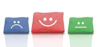 Collage colorido de almohadas con la cara sonriente y la reflexión Imagen de archivo