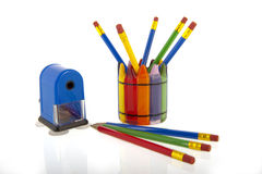Collage of pencils in a cup with a blue pencil sha Stock Photo