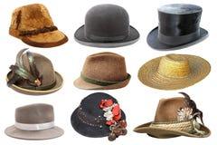 Collage con differenti cappelli sopra bianco Immagine Stock