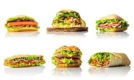 Collage con i panini e l'hamburger su fondo bianco Immagini Stock