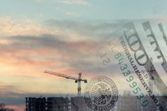 Collage with construction site and US dollars. Collage with construction site at suset and US dollars Stock Images