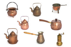 Collage of copper kettles and pots on a white background.  Stock Images