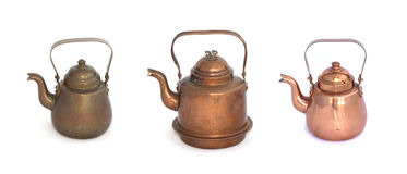 Collage of copper kettles on a white background. royalty free stock photo