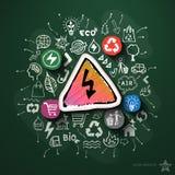 Collage d'énergie d'Eco avec des icônes sur le tableau noir Image stock