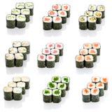 Collage de divers menu de restaurant japonais de sushi sur le fond blanc Photos stock