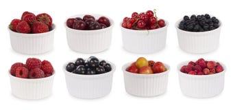 Collage de diversas frutas y de bayas aisladas en blanco Fotografía de archivo libre de regalías