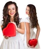 Collage de jolie jeune femme tenant la boîte en forme de coeur photographie stock