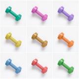 Collage de pesas de gimnasia coloridas en el fondo blanco Fotos de archivo libres de regalías