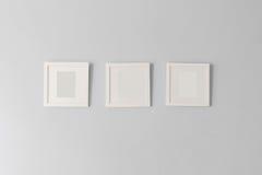 Collage de trois cadres blancs de photo Images libres de droits