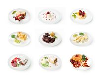 Collage dei dessert del ristorante isolati su bianco Fotografia Stock