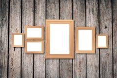 Collage dei telai di legno marroni in bianco, derisione interna della decorazione su sopra fotografie stock libere da diritti