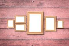 Collage dei telai di legno marroni in bianco, derisione interna della decorazione su sopra fotografie stock