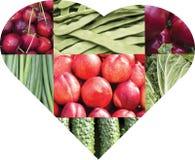 Collage della frutta e delle verdure sotto forma di cuore Fotografia Stock
