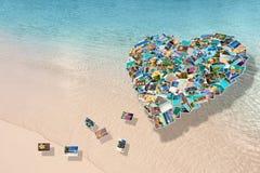 Collage delle foto sotto forma di un cuore su una spiaggia Fotografie Stock Libere da Diritti