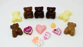 Collage der süßen Schokolade auf dem Weiß Lizenzfreies Stockfoto