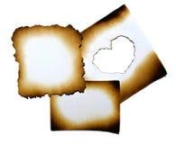 Collage di carta bruciato con cuore Immagini Stock