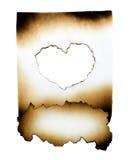 Collage di carta bruciato con cuore Immagine Stock