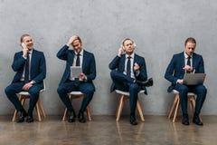 collage di giovane uomo d'affari clonato fotografie stock libere da diritti