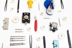 Collage di vari strumenti per la riparazione dell'orologio Immagine Stock Libera da Diritti