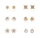 Collage of diamond earrings Stock Photos