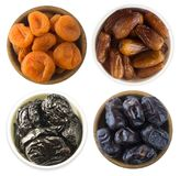 Collage of different dried fruits. Dried prunes, dried apricots and dates isolated on white background. Top view. Dried fruits iso. Lated on a white background royalty free stock images