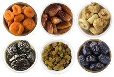 Collage of different dried fruits. Dried prunes, dried apricots, raisins, dates, figs isolated on white background. Top view. Drie. D fruits isolated on a white Royalty Free Stock Photos