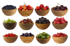 Collage of different fruits and berries isolated on white. Set of strawberries, raspberries, currants, blackberries, gooseberries, grapes, bilberries and Royalty Free Stock Image