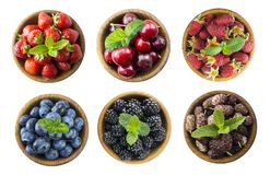Collage of different fruits and berries. Raspberries, strawberries, cherries, mulberries, blueberries, blackberries with mint leav. Berries and fruits isolated stock photos