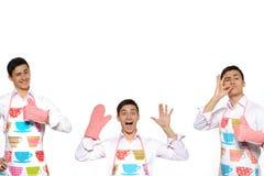 Collage drôle avec trois hommes à cuire Photographie stock libre de droits